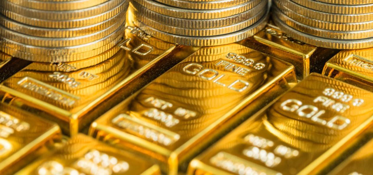 Gold goes down as improved economic surge output spurs risk appetite